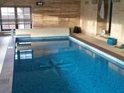Строительство переливного бассейна в частном доме