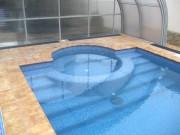 Строительство бассейна с зоной гидромассажа в пристройке к дому с раздвижным павильоном